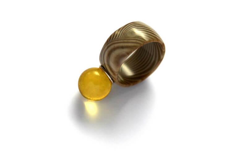 Andrzej Szadkowski - ring with a striped flint and an amber