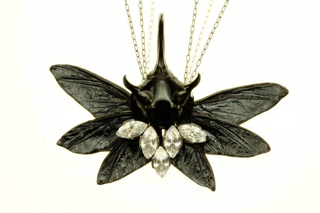 Necklace by Bartosz Maria Chmielewski; Materials: silver, oxidised silver chitin, leaf beetle, epoxy resin