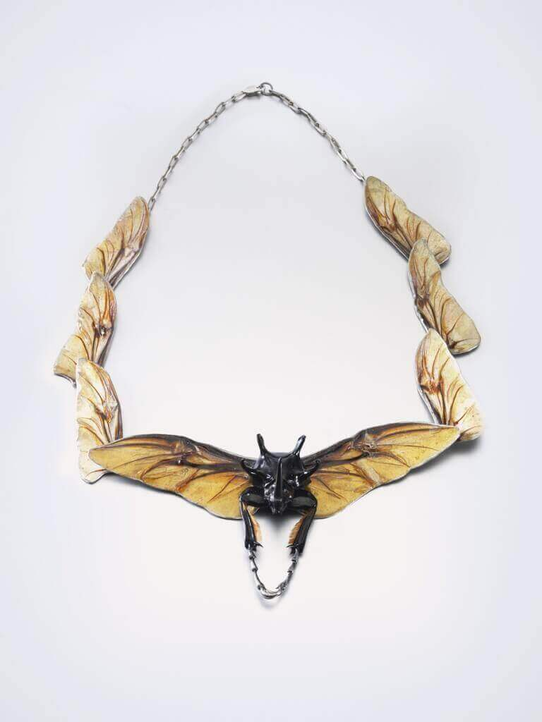 Necklace with beetle by Bartosz Mary Chmielewski; Materials: silver, chitin, beetle wings