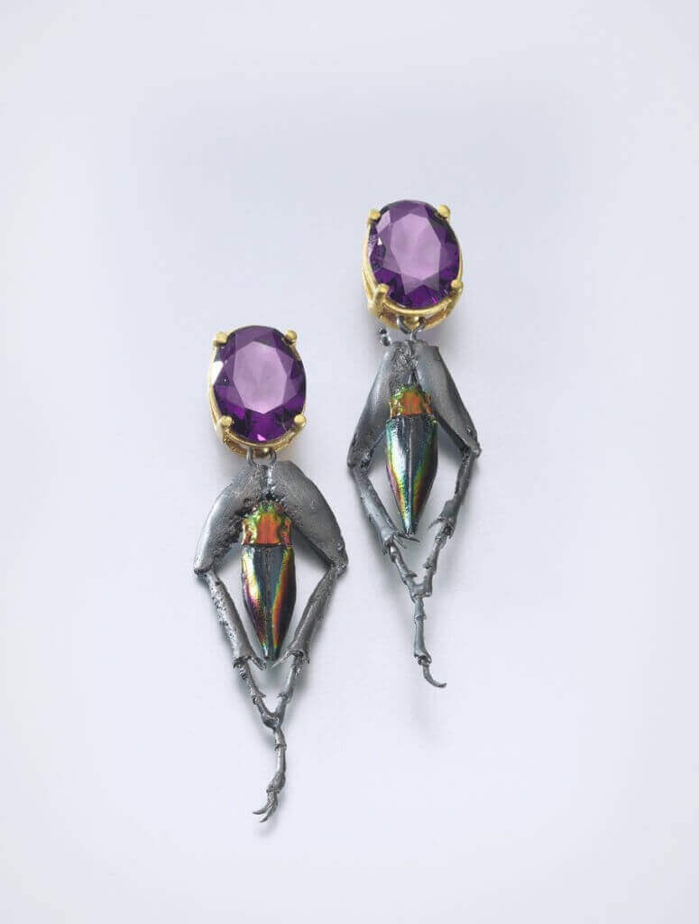 Earrings by Bartosz Maria Chmielewski; Materials: gold-plated silver, oxidised silver, rhinestones, chitin
